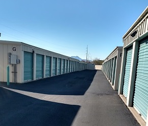 paved path through two rows of storage units