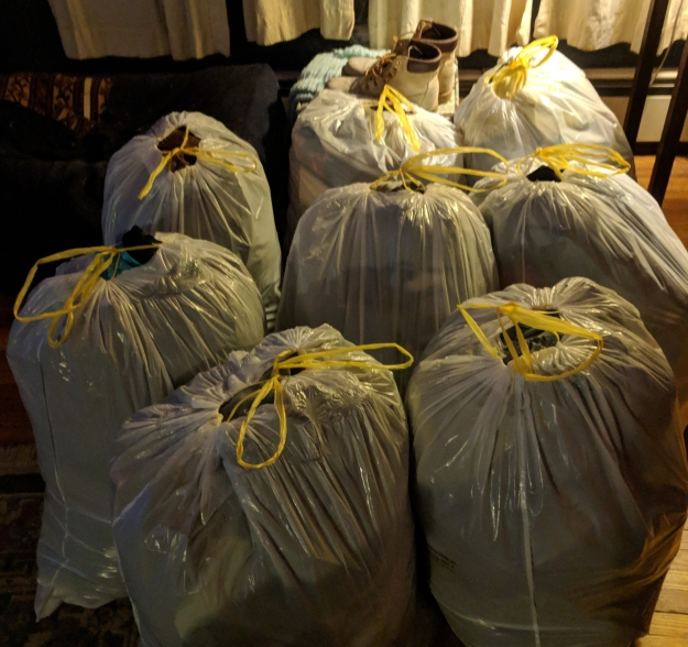 Eight trash bags full of clothing to be donated